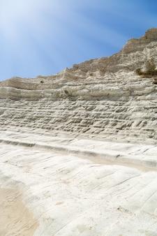 White scala big cliff in sea.
