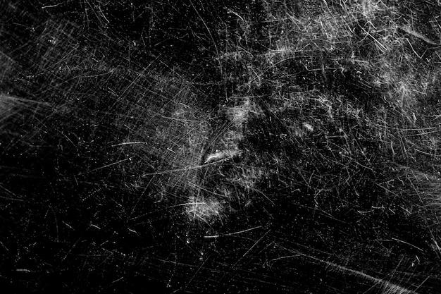 黒の背景に白い傷。混沌とした傷のあるガラス。高品質の写真