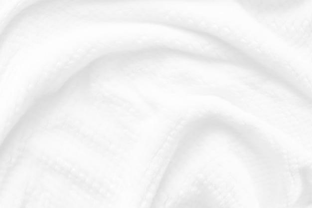 Текстура белого мохнатого одеяла как фон