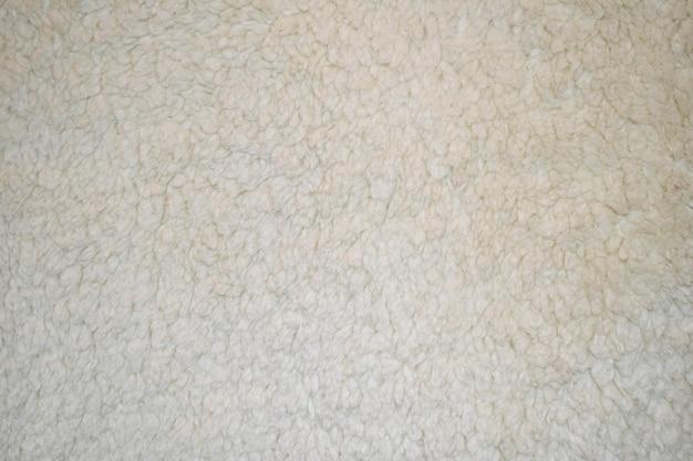 繊維の質感のある白い羊の毛皮さまざまな目的のための柔らかいキャンバスのパターン