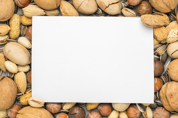 A white sheet of paper on the surface of a nut mixture