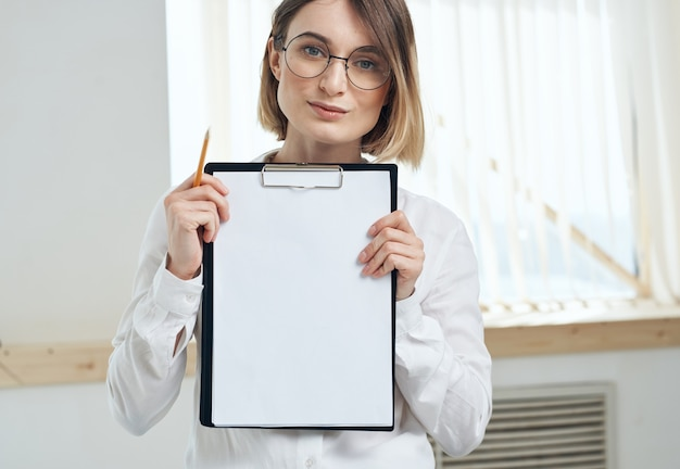White sheet of paper woman rooming near window interior folder with documents