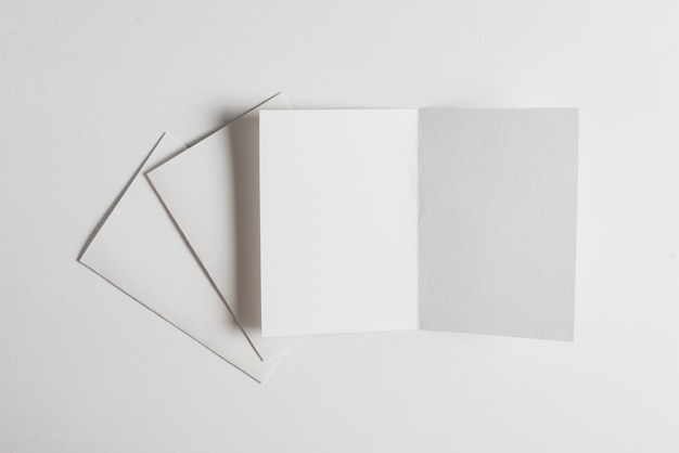 White sheet of papers on white backdrop