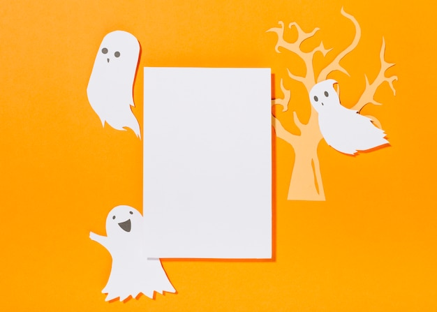 White sheet with paper tree and ghosts