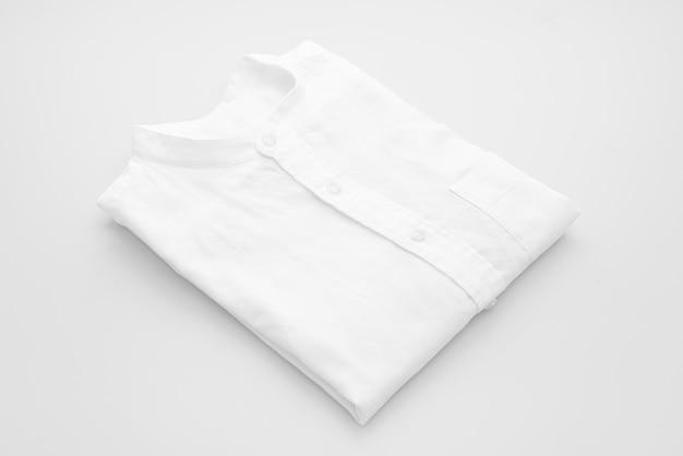 White shirt fold on white surface