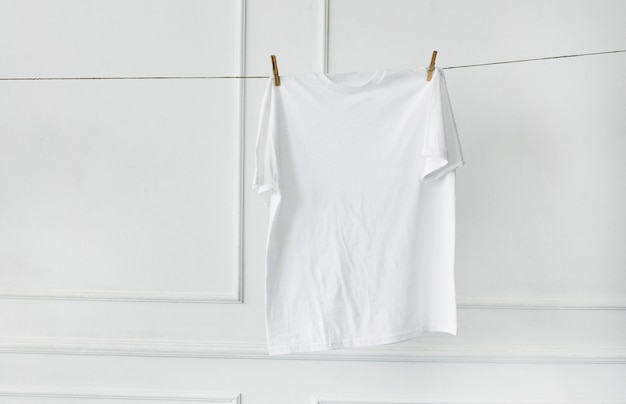 White shirt hanging by the wall