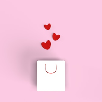 White shopping bag with red hearts on pink background