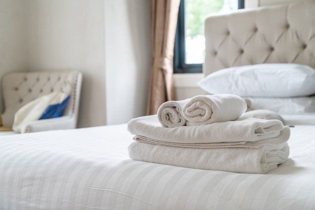 White shower towel on bed