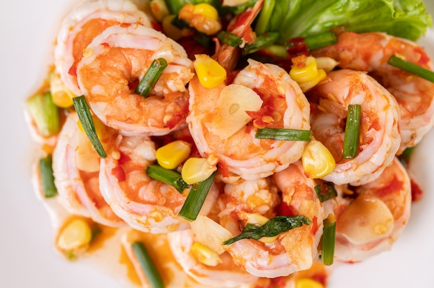White shrimp salad with lettuce corn and scallions