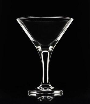 Белый силуэт пустого бокала для коктейля мартини на черной спине