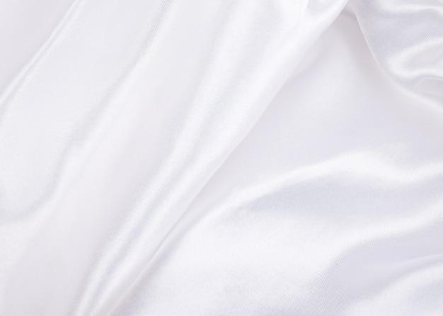 シルクの背景またはテクスチャとしての白いシルク
