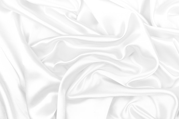 White silk texture luxurious satin for abstract background. beautiful white fabric, soft focus