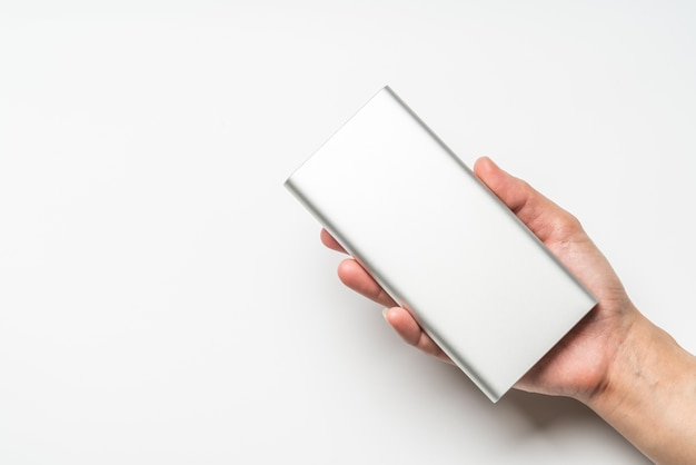 White silver power bank on hand. save energy and reduce energy efficiency