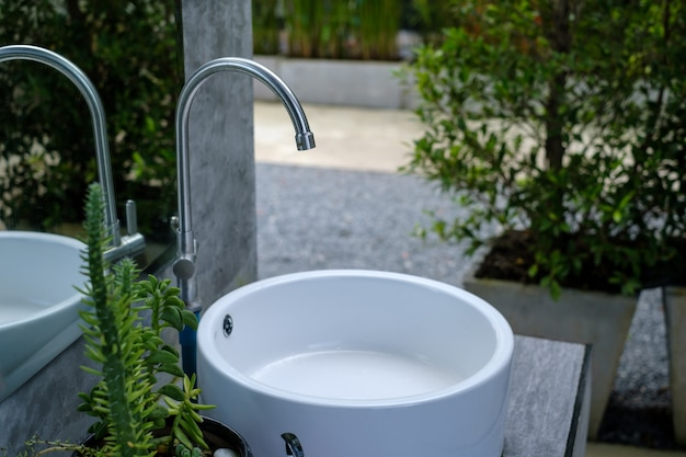 White sinks placed in the garden