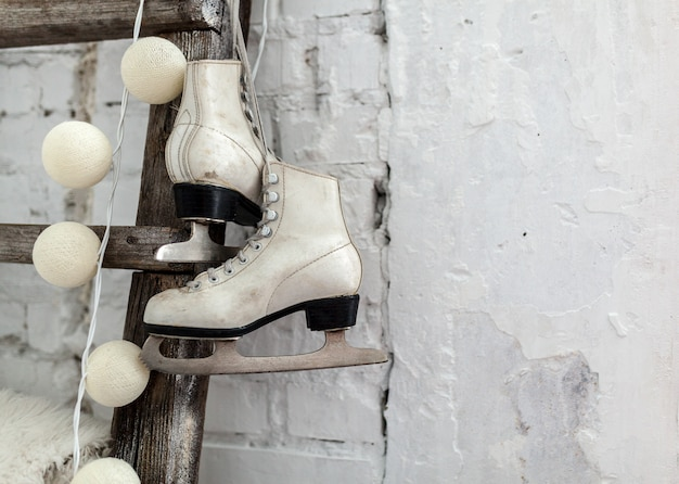 White skates at the wooden staircase happy new year