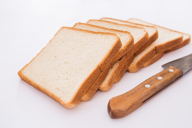 White slices of bread and a knife on a white background. toast bread.