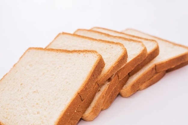 White slices of bread on a white background. toast bread.