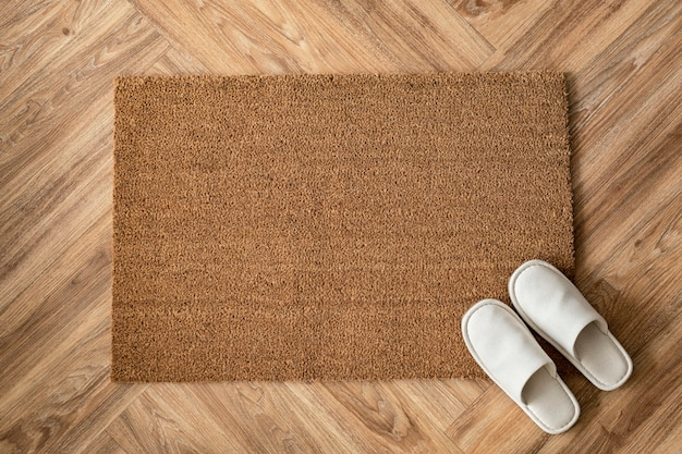 White slippers on a doormat
