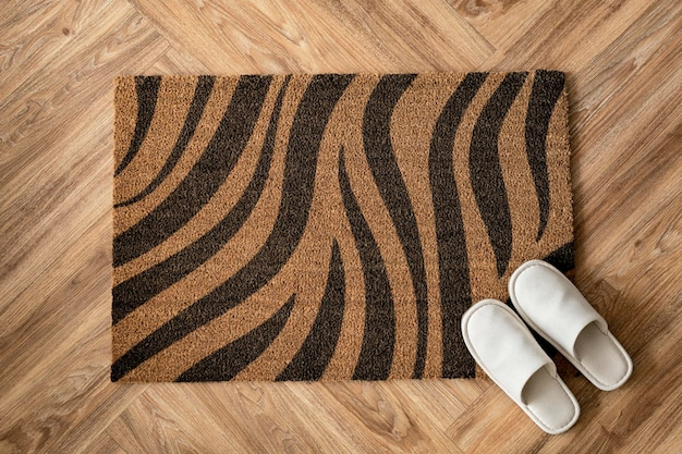 White slippers on a leopard print  doormat