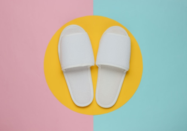 White slippers on a pastel colored