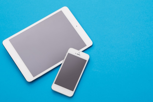 White smart phone and tablet