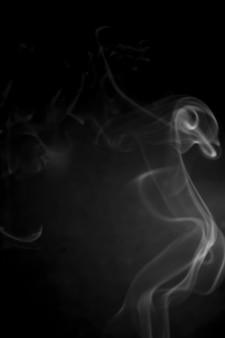 White smoke on black background.