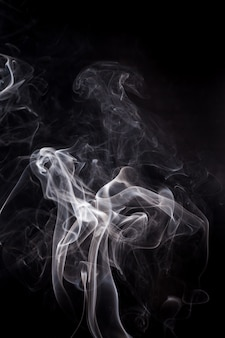 White smoke on a black background. Premium Photo