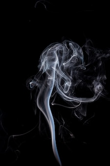 White smoke on black background.