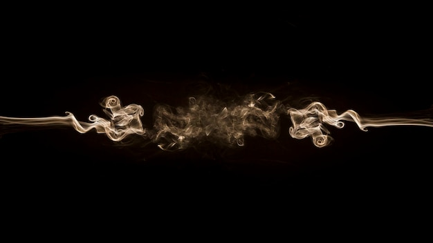 White smoke fragments design on a black background
