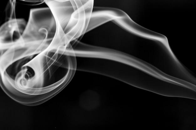 White  smoke motion on black background.