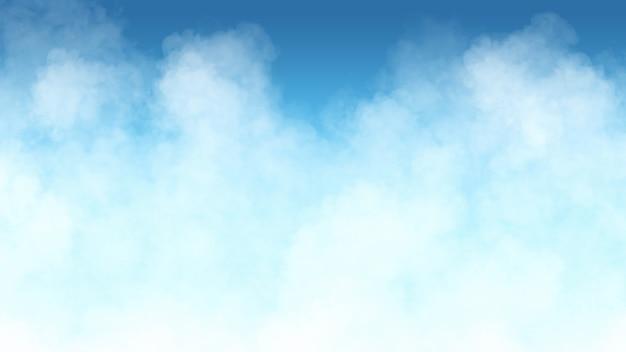 青い背景の上の白い煙
