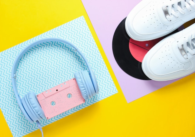 White sneakers, headphones with audio cassette, lp record.