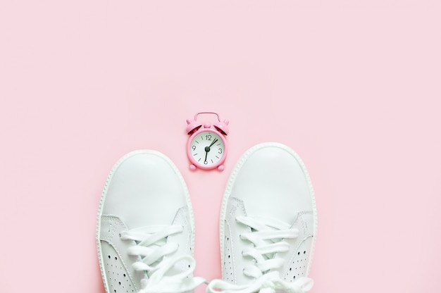 White sneakers on a pink background in a pink watch