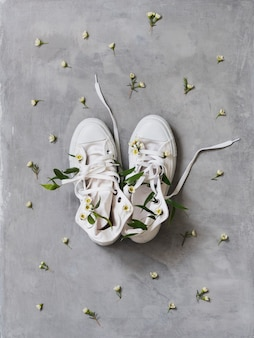 White sneakers with white flowers inside