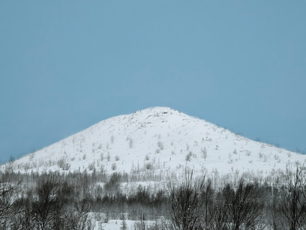 White snow covered the top of the hill. snowy arctic hill.