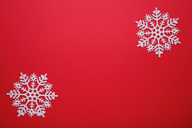 White snowflake on a red background