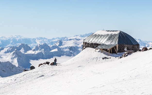 White snowy winter caucasus mountains at sunny day. panorama view from ski slope elbrus, russia