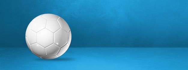 White soccer ball isolated on a blue studio banner. 3d illustration