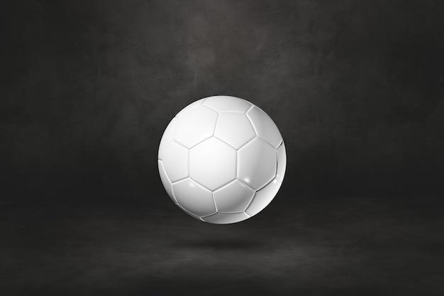 黒いスタジオの背景に分離された白いサッカーボール。 3dイラスト