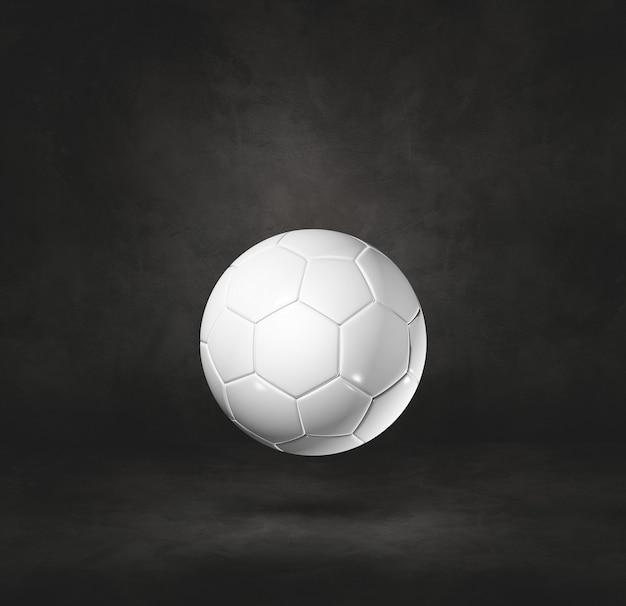 검은 스튜디오 배경에 고립 된 흰색 축구 공. 3d 일러스트레이션