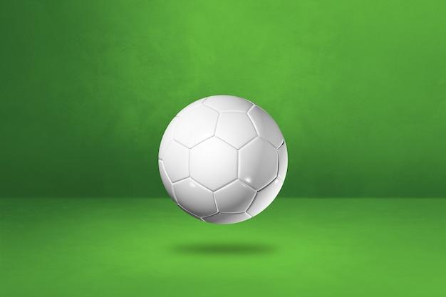 緑のスタジオの背景に分離された白いサッカーボール。 3dイラスト
