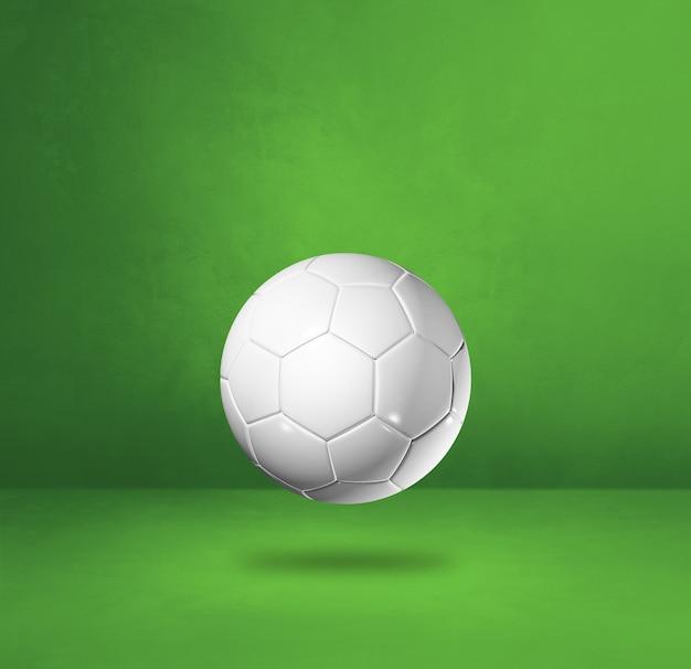 Белый футбольный мяч, изолированные на зеленой студии