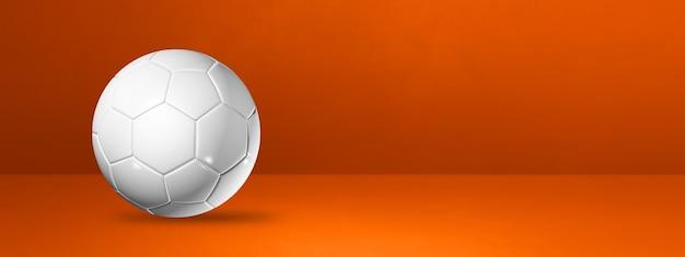 オレンジ色のスタジオバナーに分離された白いサッカーボール。 3dイラスト