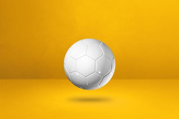 Белый футбольный мяч, изолированные на желтом. 3d иллюстрации