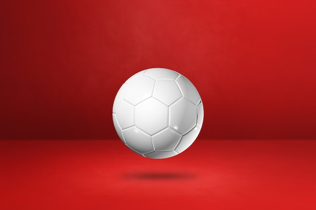 White soccer ball isolated on a red  background. 3d illustration
