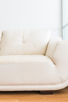 White sofa near glass partition