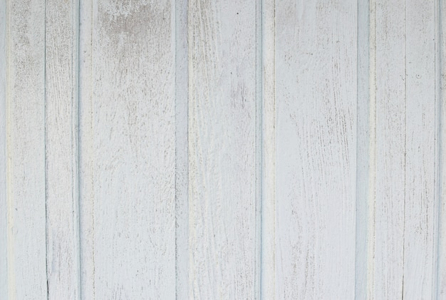 White soft wood surface as background. white vintage weathered wooden texture.