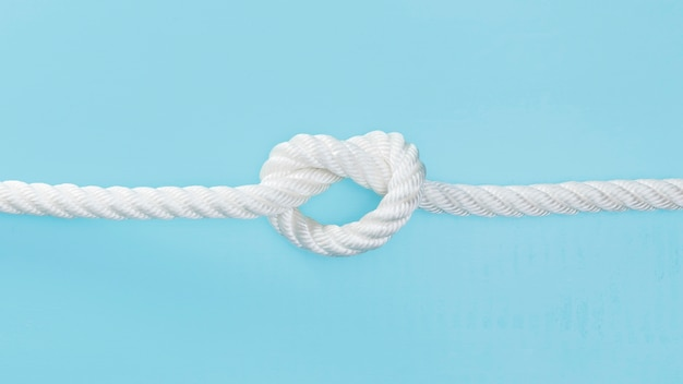 White solid rope with a knot