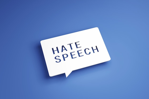 White speech bubble with text hate speech on blue background.
