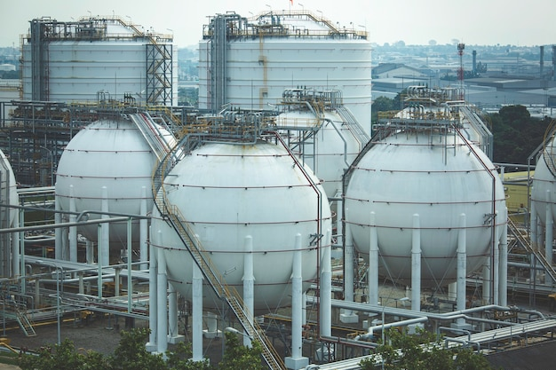 White spherical propane tanks containing fuel gas pipeline and scaffolding work